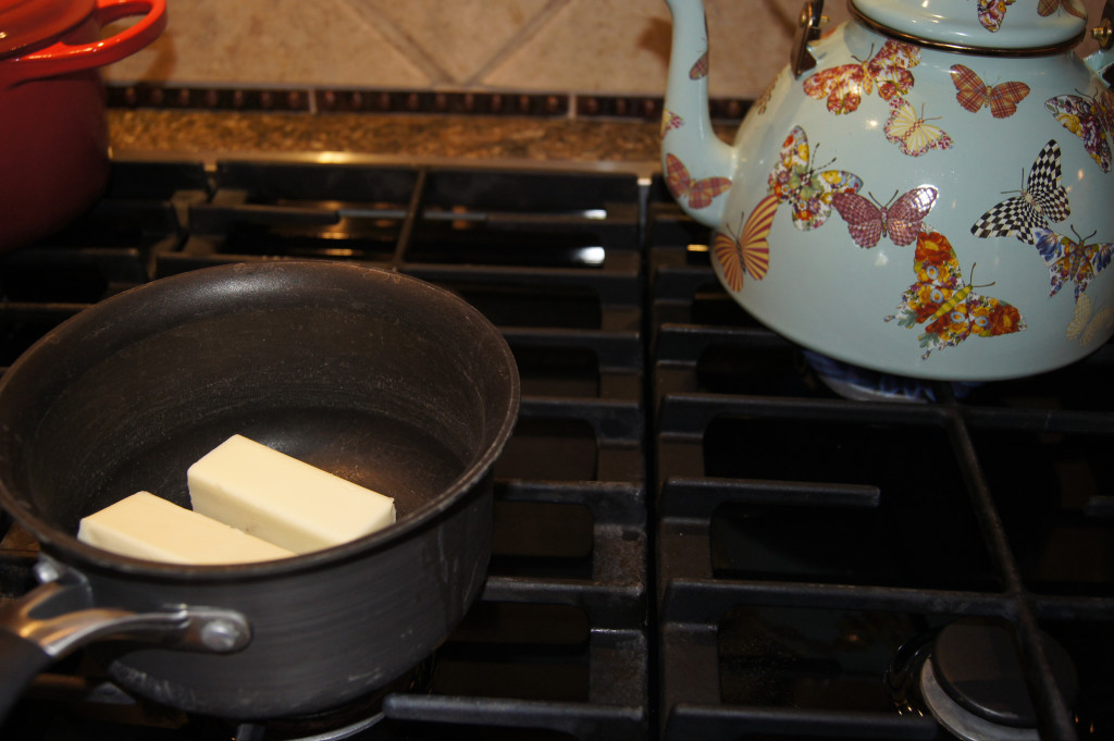 Step 2: Boil water in a tea kettle for one cup of hot water. In a sauce pan, melt 1 stick butter and 1/2 cup of shortening (or simply 2 sticks of butter), 4 Tbsp. of cocoa and one cup of boiling water. Mix well and bring to a boil.
